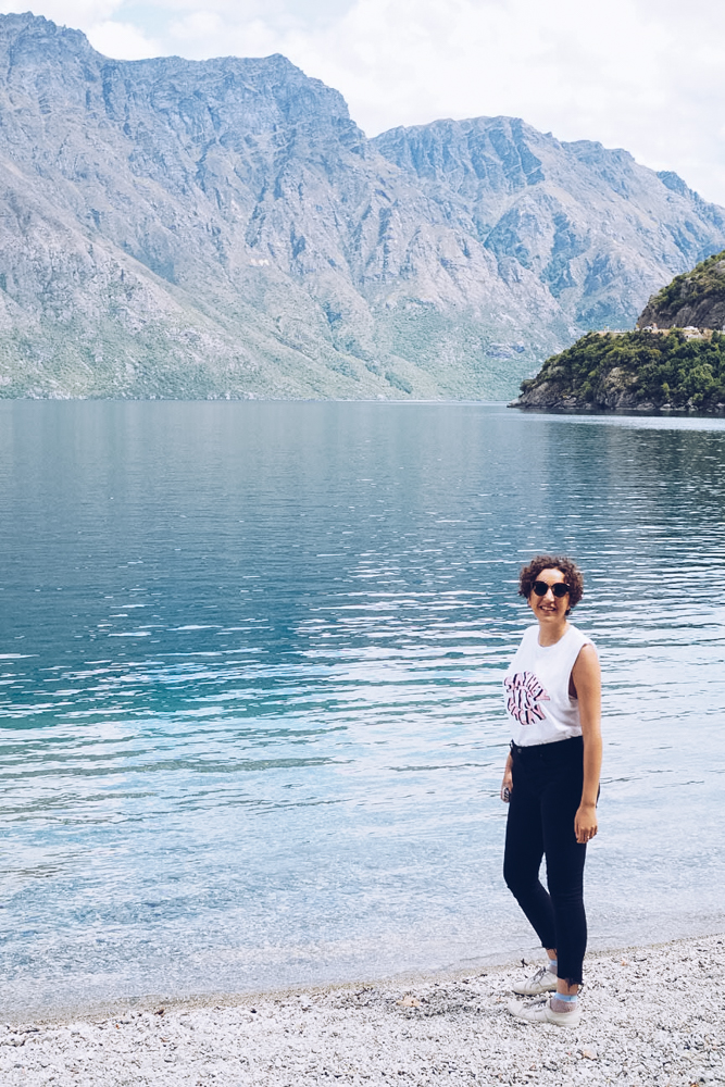 Woman standing on edge of Lake Wakatipu in New Zealand