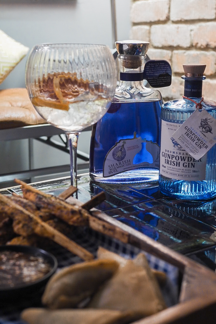 Sharish blue gin, drumshanbo gunpowder gin and indian snack food