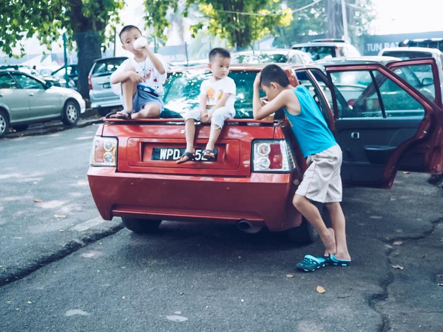 Children outside Imbi Market in Kuala Lumpur