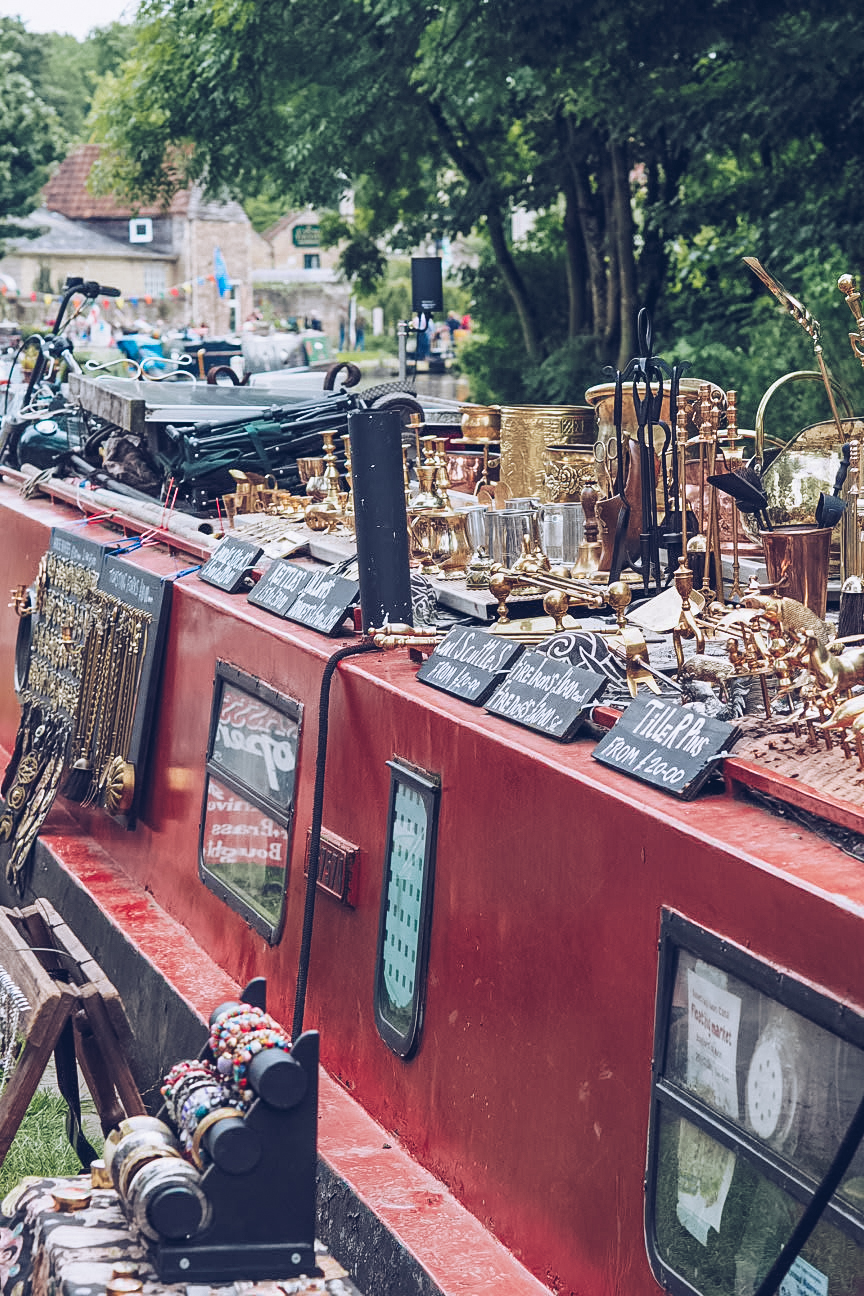Narrowboat with products for sale on top of it