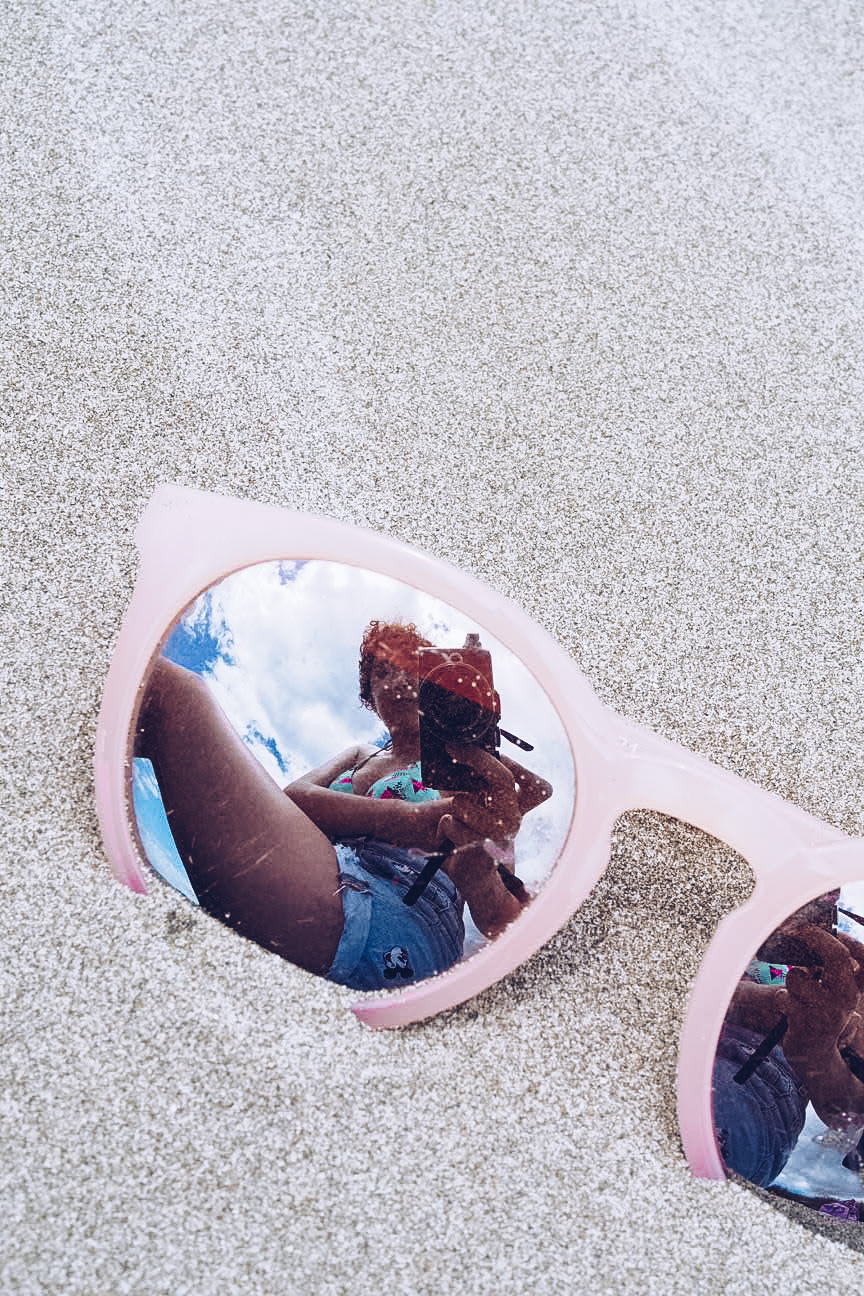 Reflection in mirror sunglasses on beach