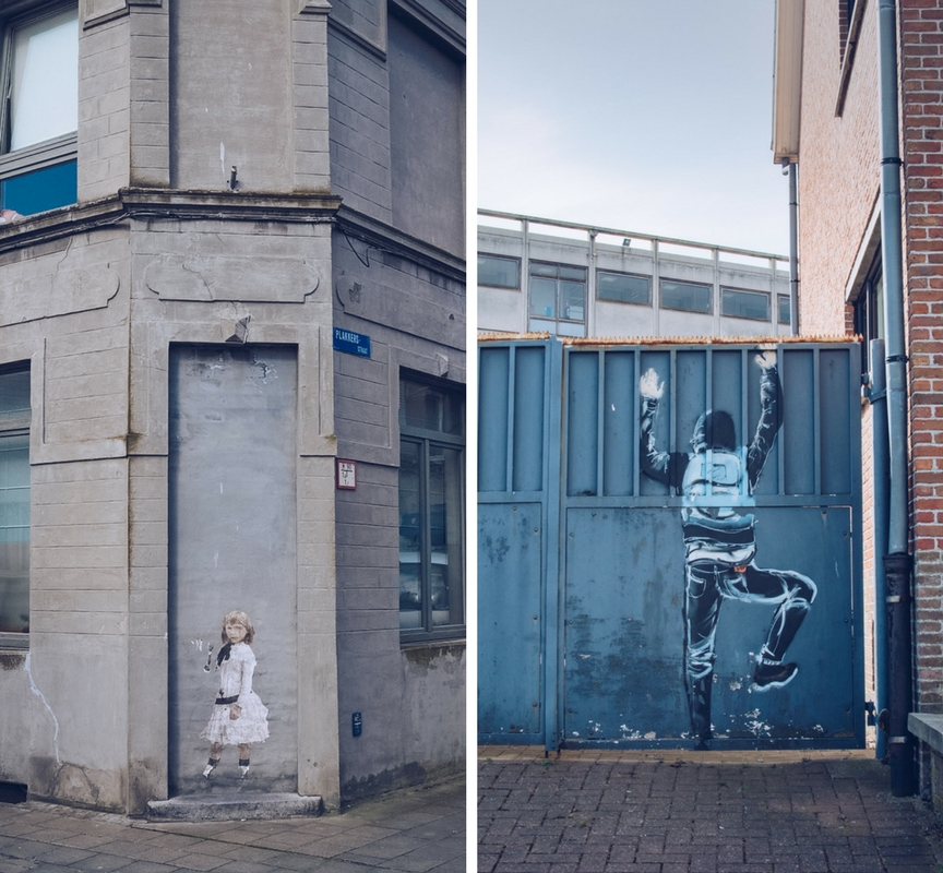 street art of a young girl and hooded person climbing a gate