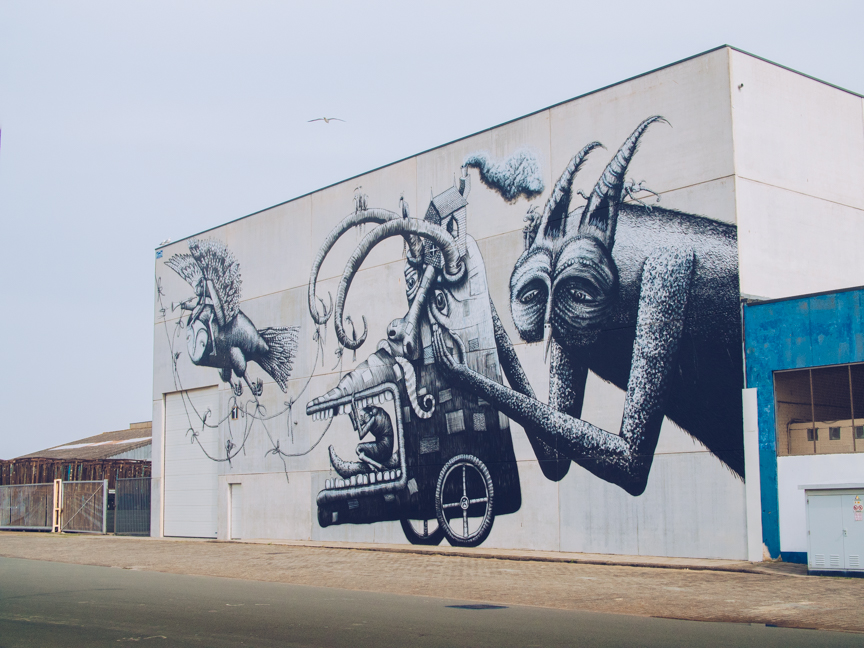 surreal street art by phlegm in ostend