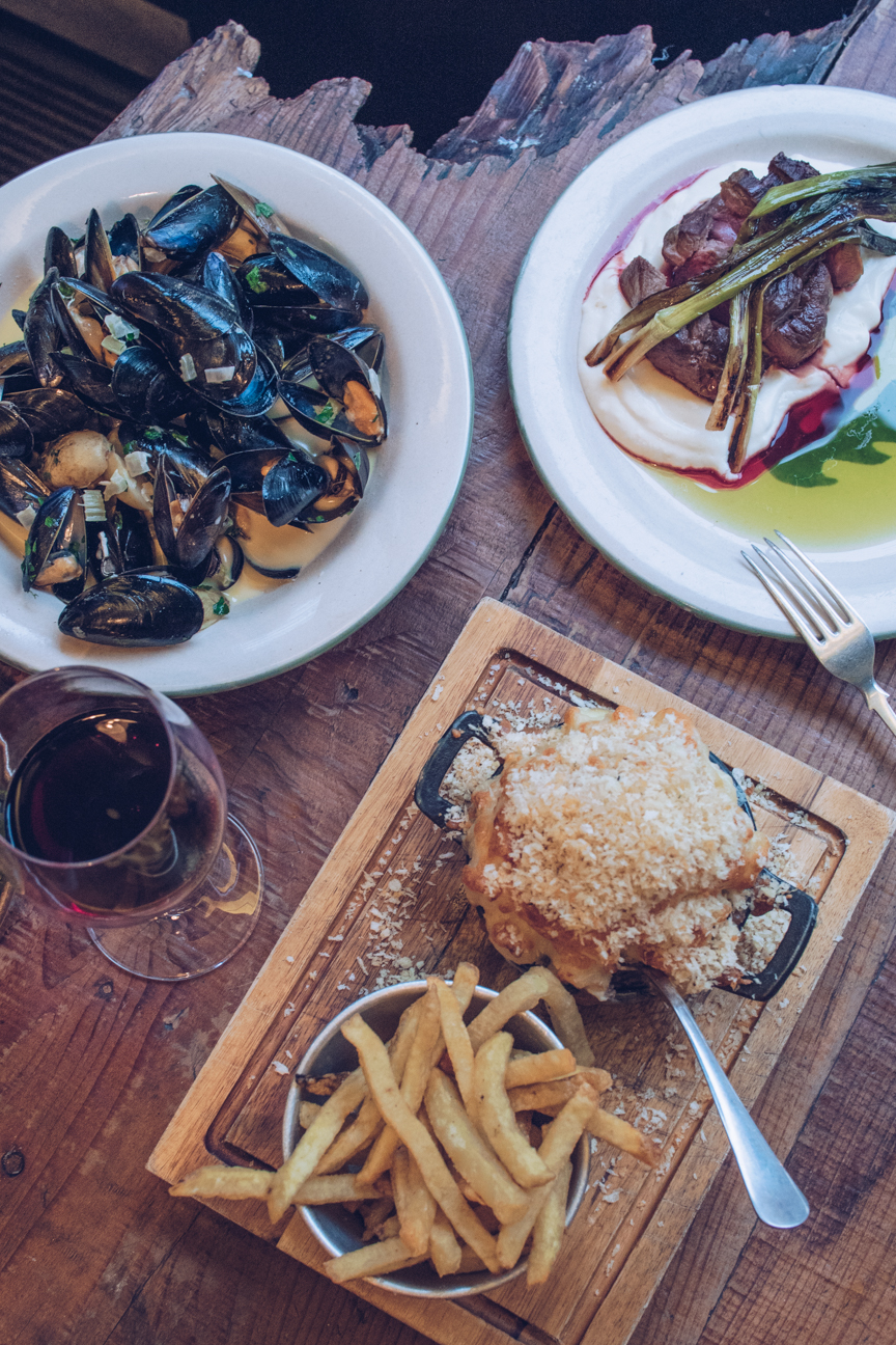Mussels, lamb rump, mac and cheese, fries, glass of red wine
