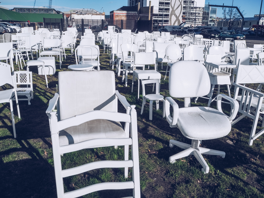 185 white chairs installation in christchurch