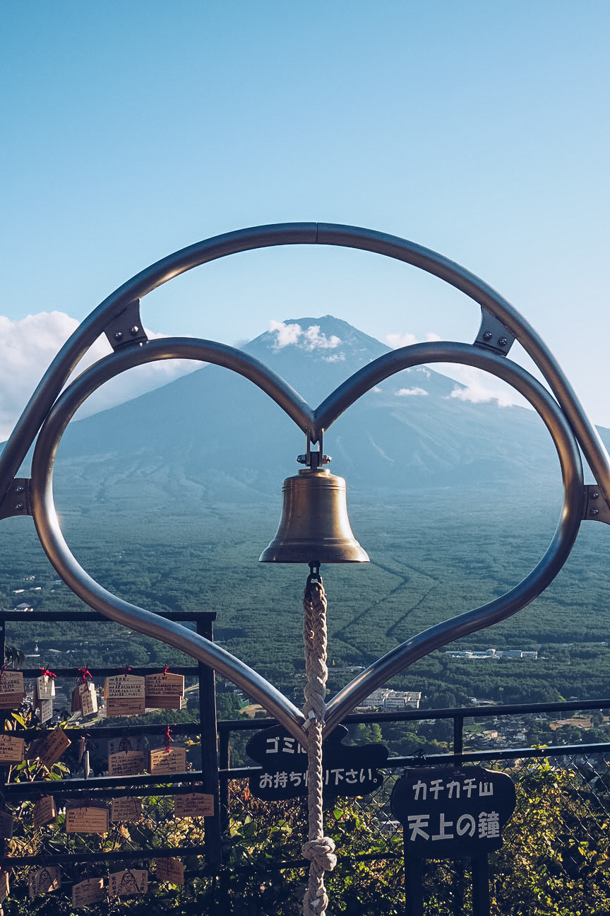 mount fuji with heart and bell in front of it