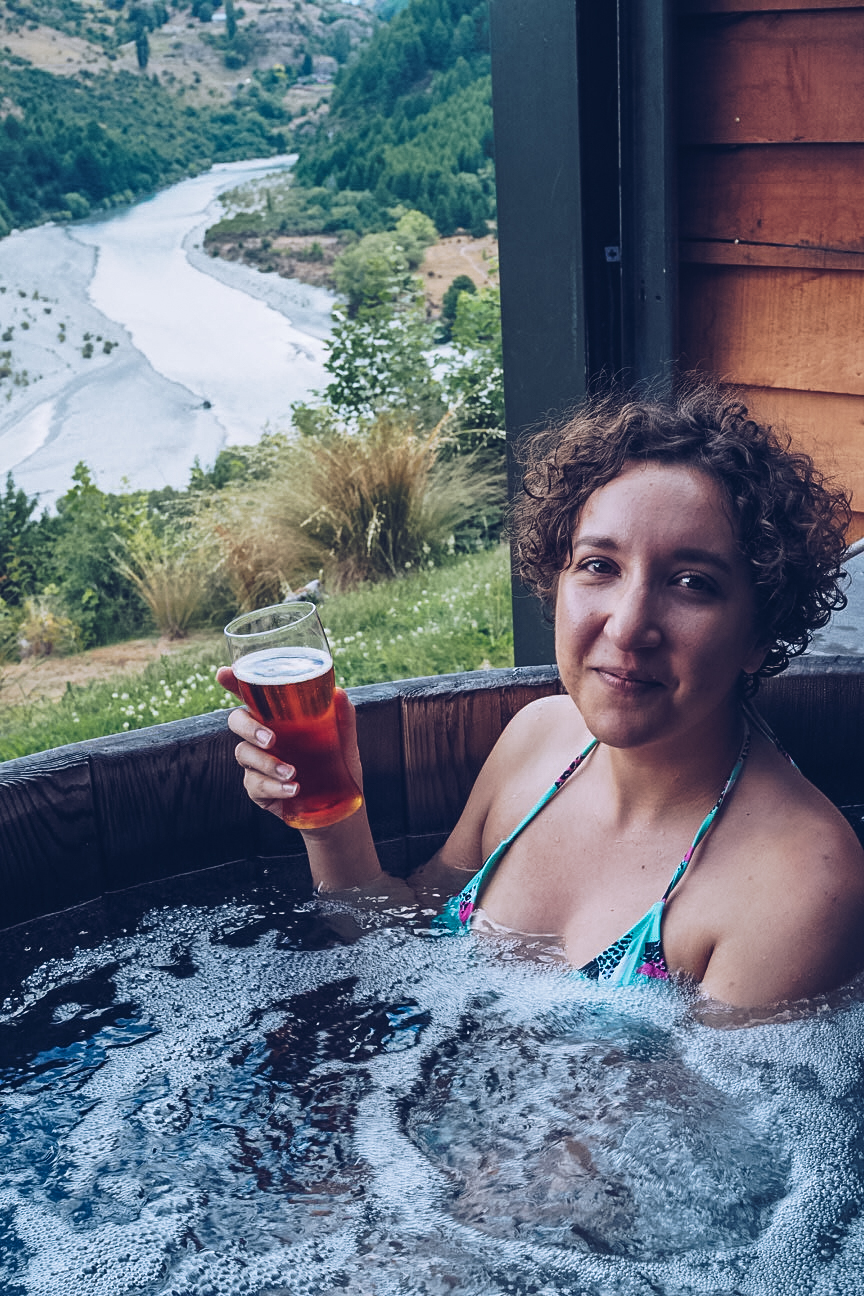 drinking beer in onsen hot pools queenstown