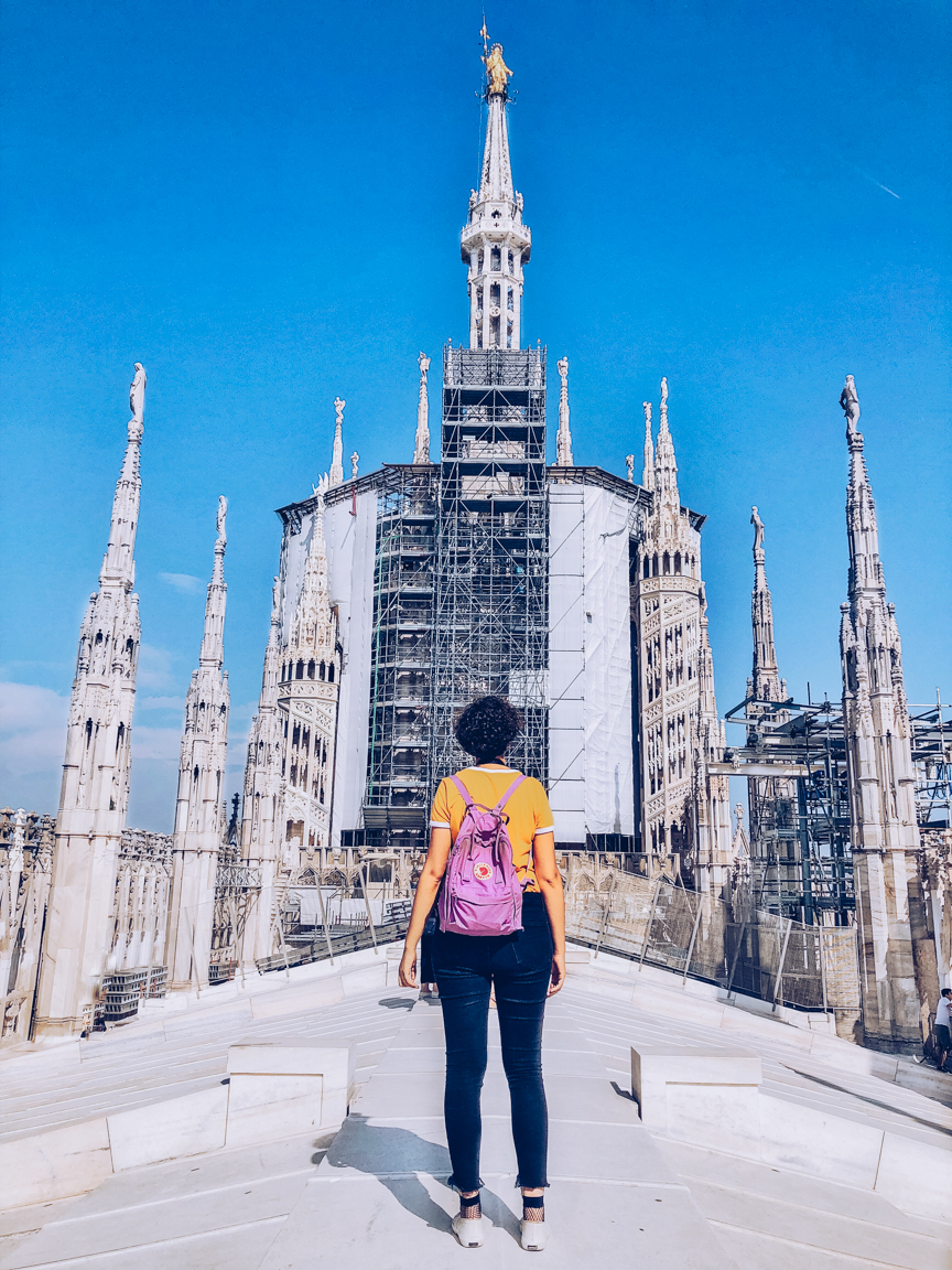 travel blogger on top of duomo roof in milan