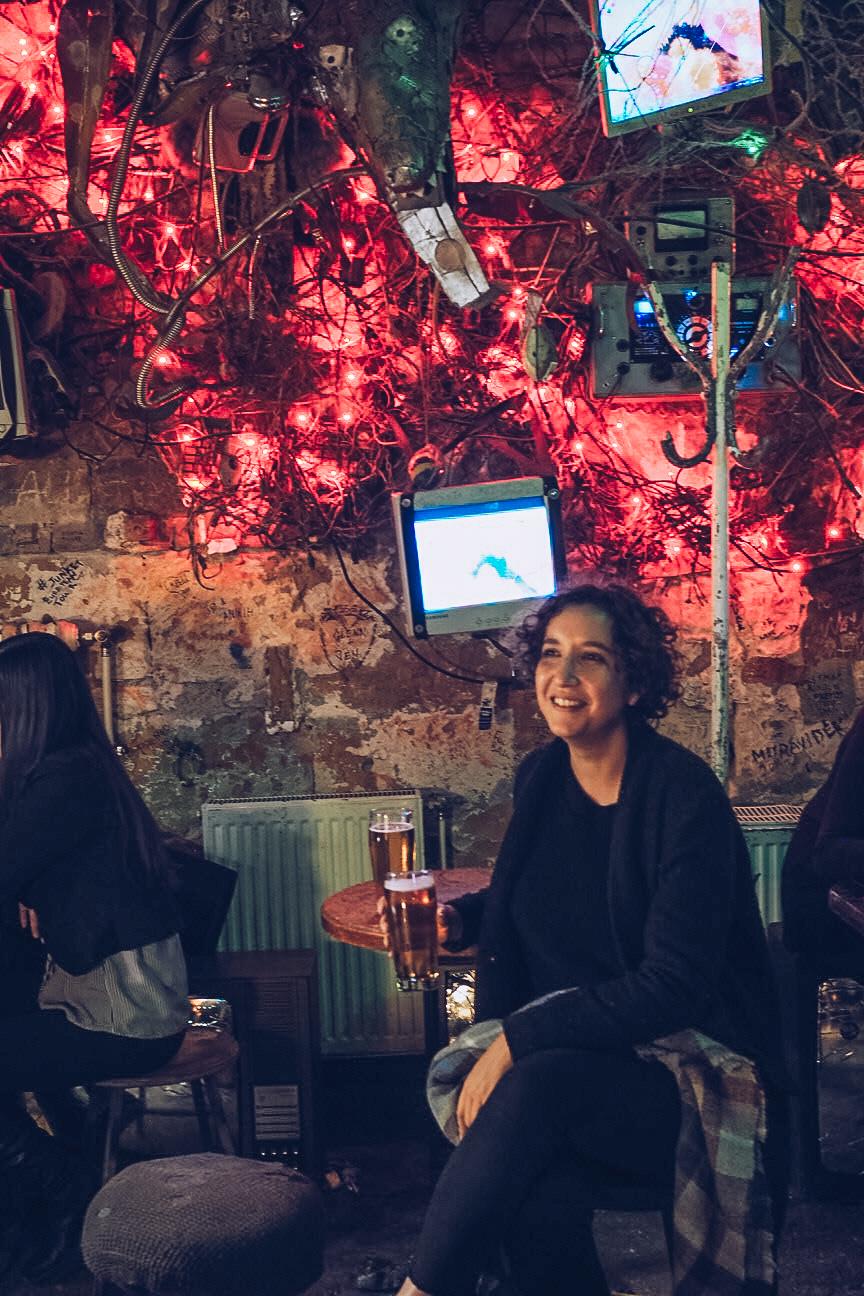 drinking in szimpla kert ruin bar in budapest
