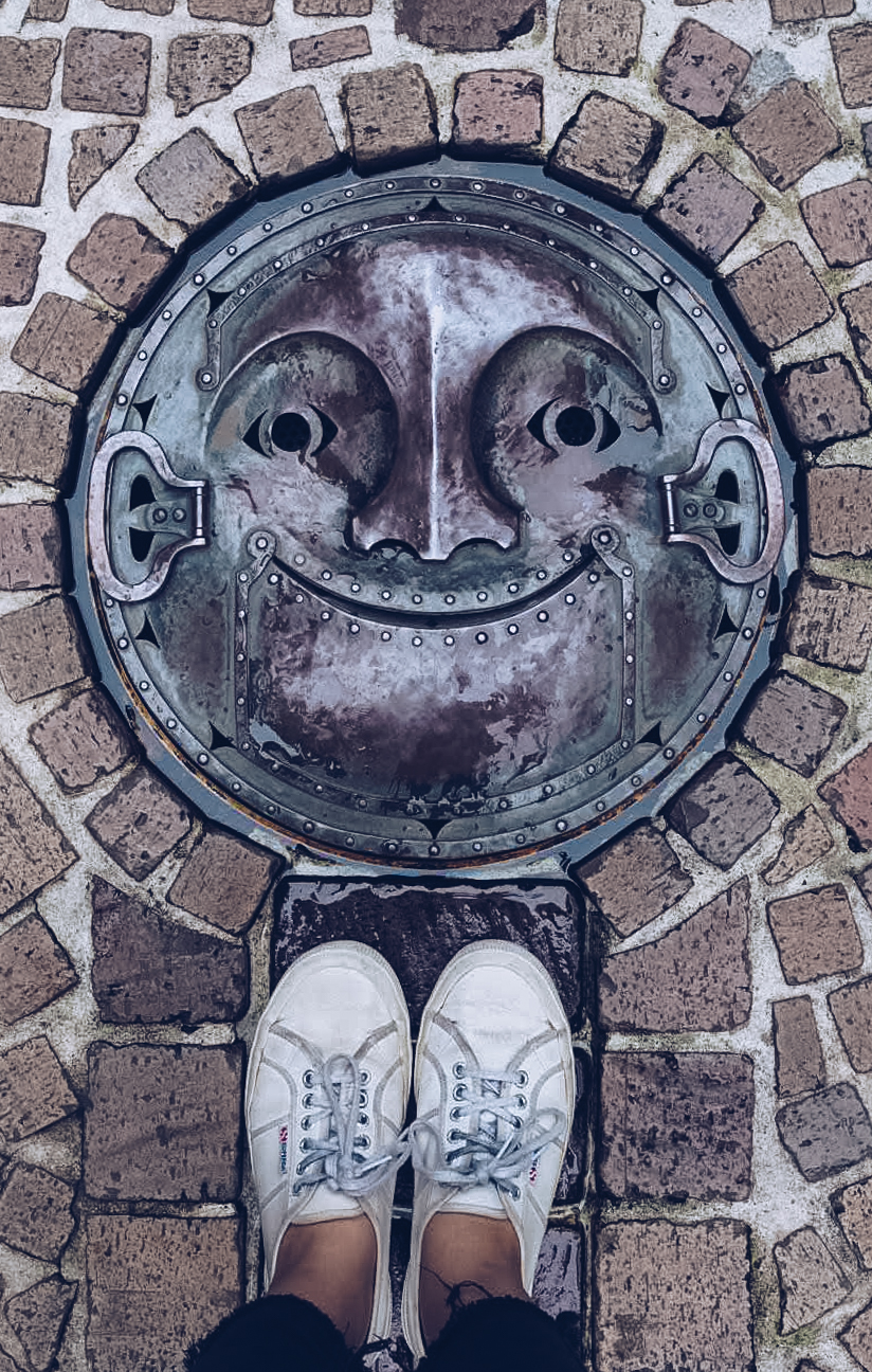 smiling drain cover at studio ghibli museum