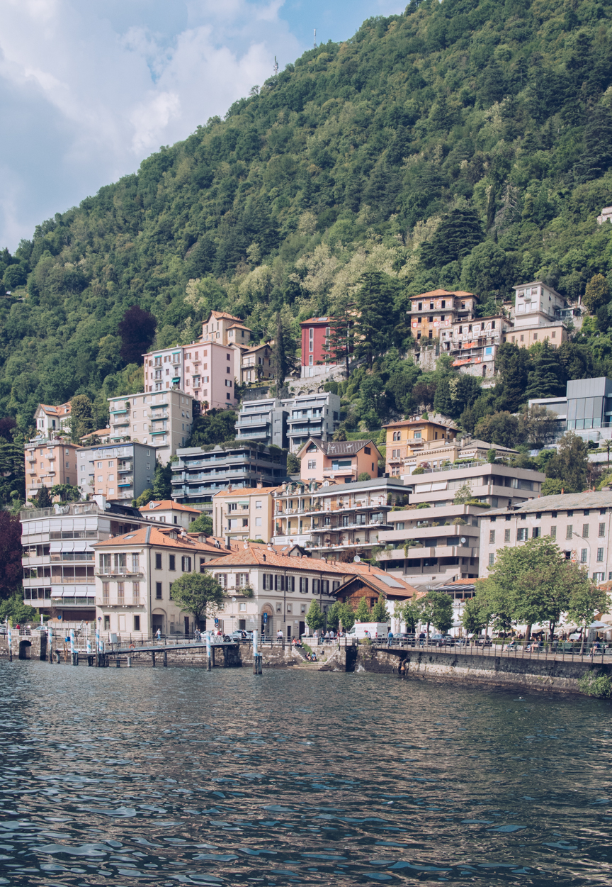houses built into the hills on the lake como waterfront