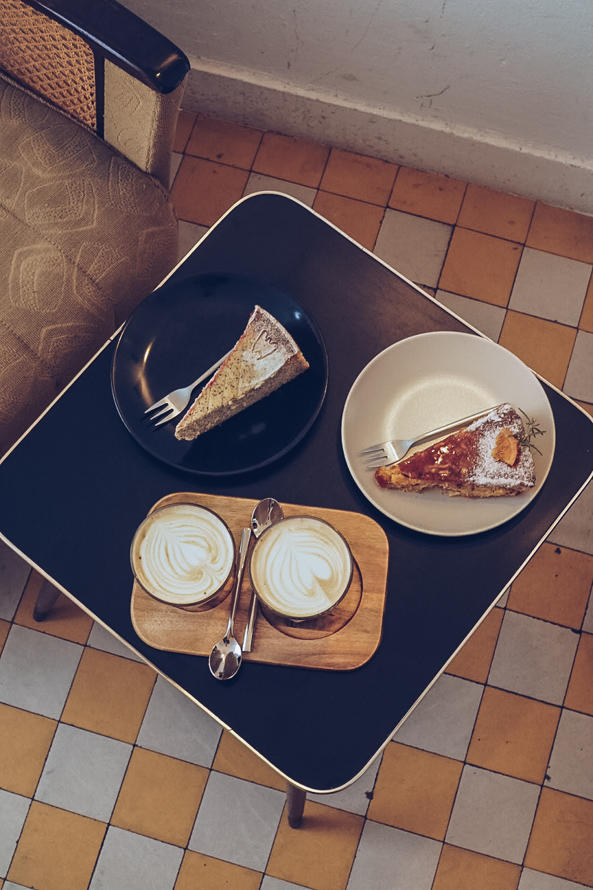 cheesecake and chai lattes on a table