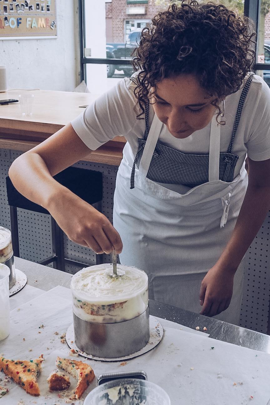 woman icing cake