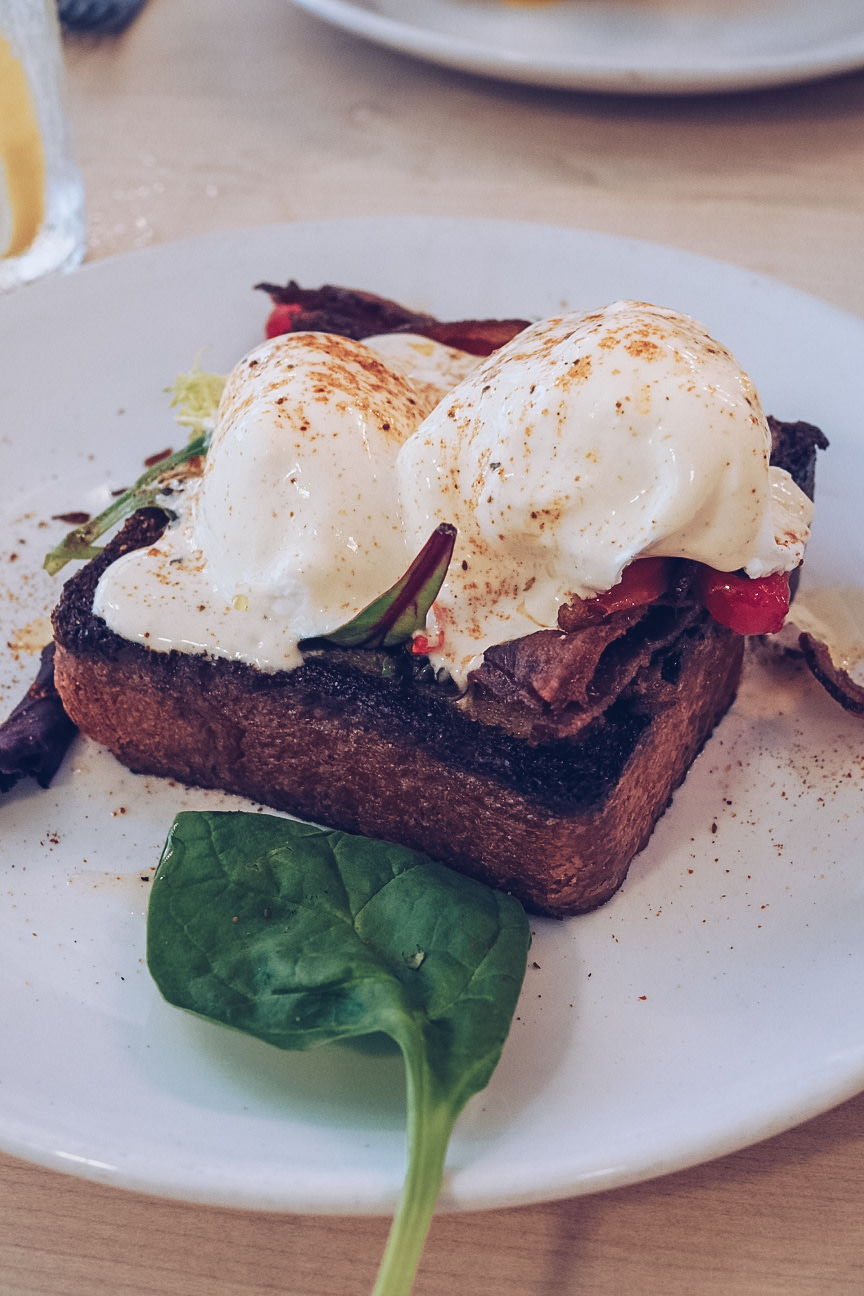 Eggs benedict and bacon on brioche toast