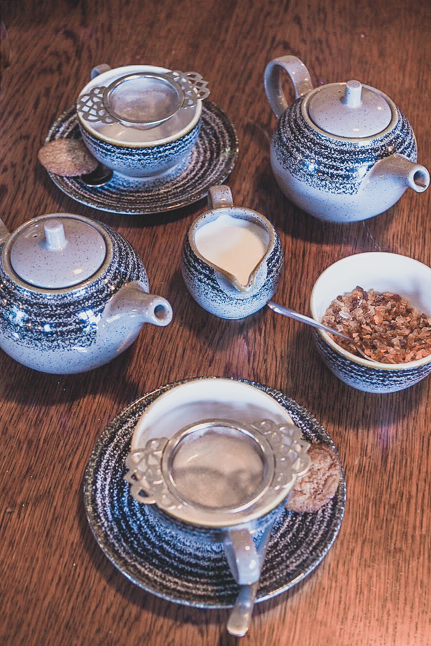 china tea set with raw brown sugar and milk jug