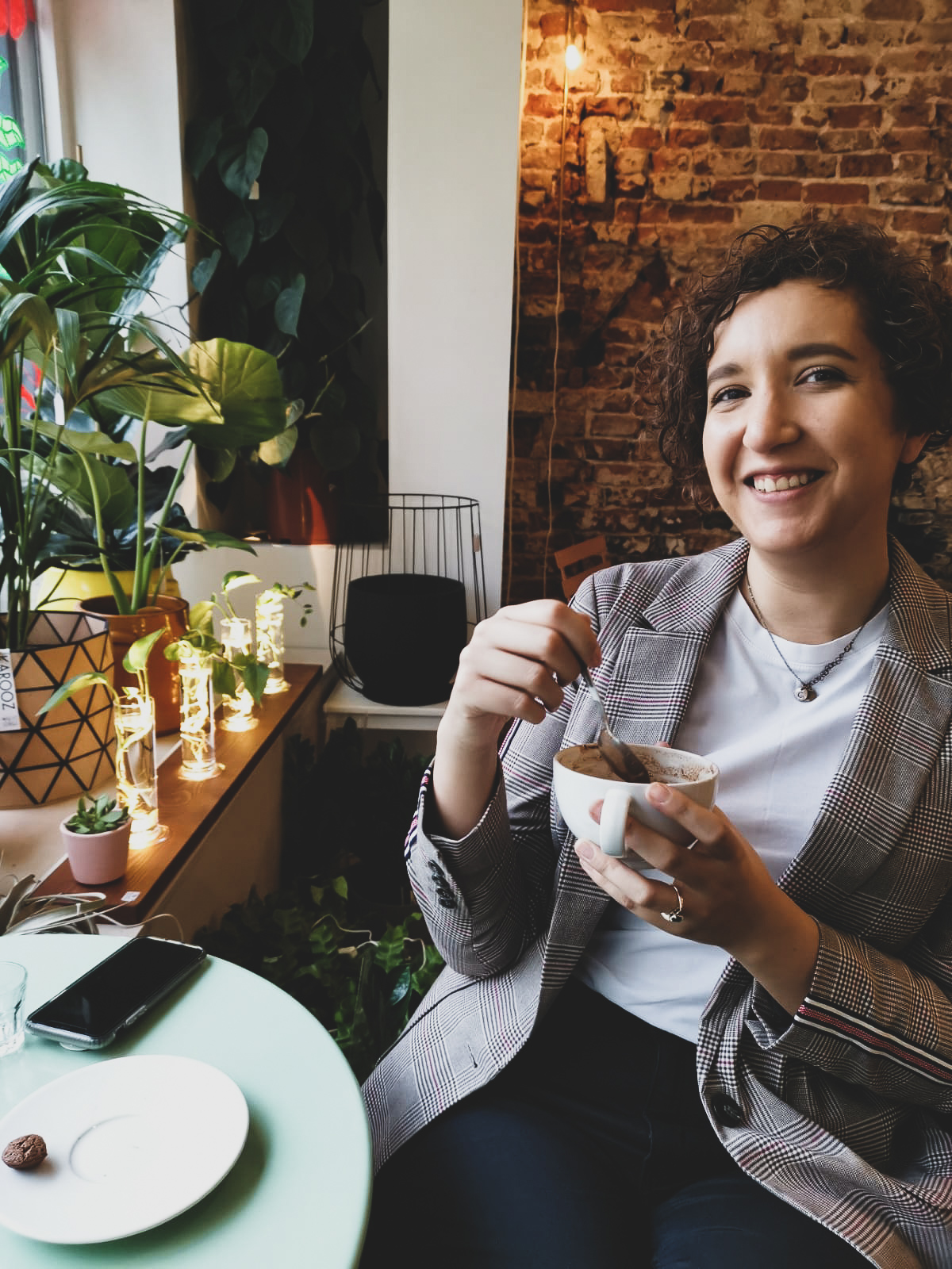 woman in coffee shop with plants