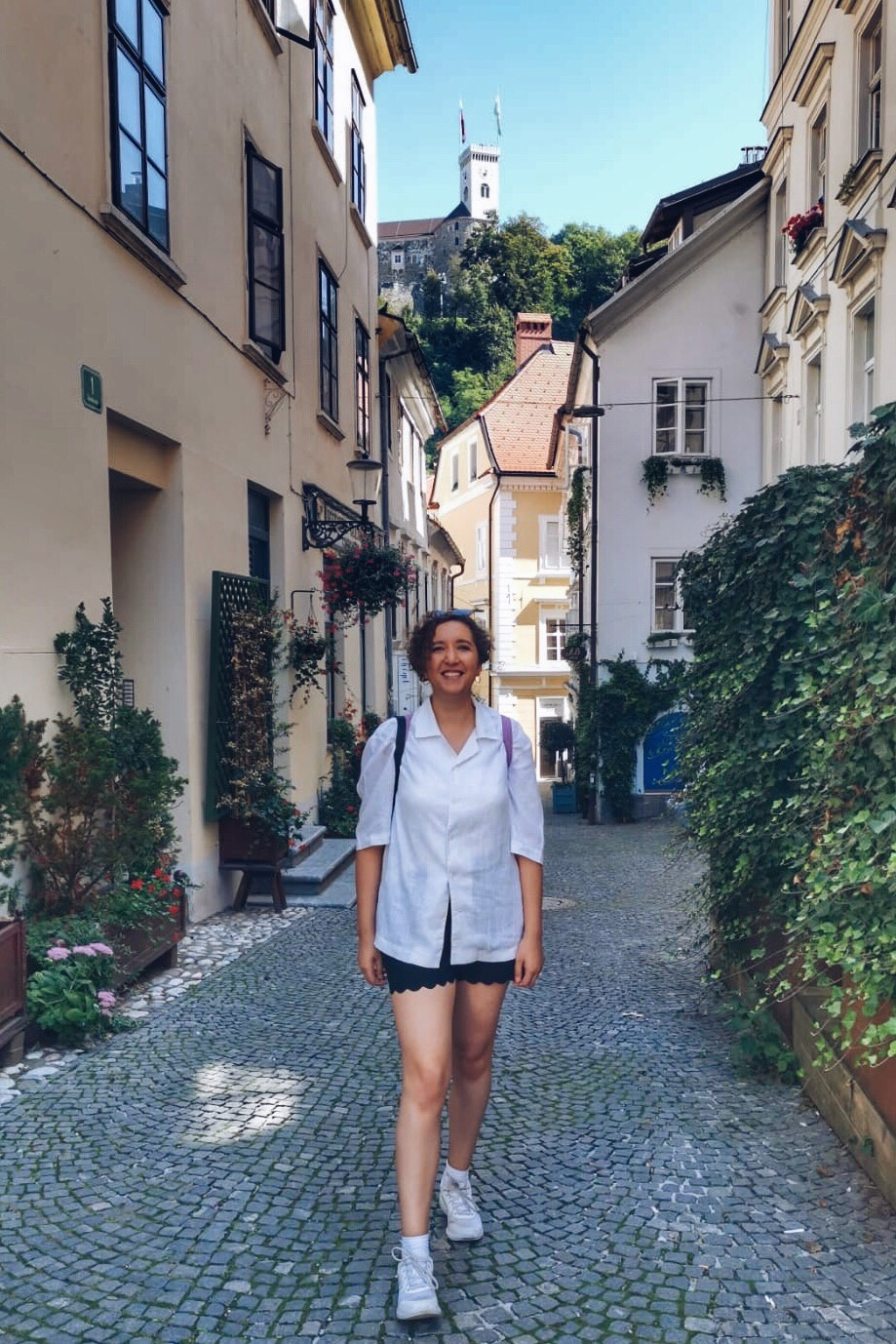 woman walking through old streets in ljubljana
