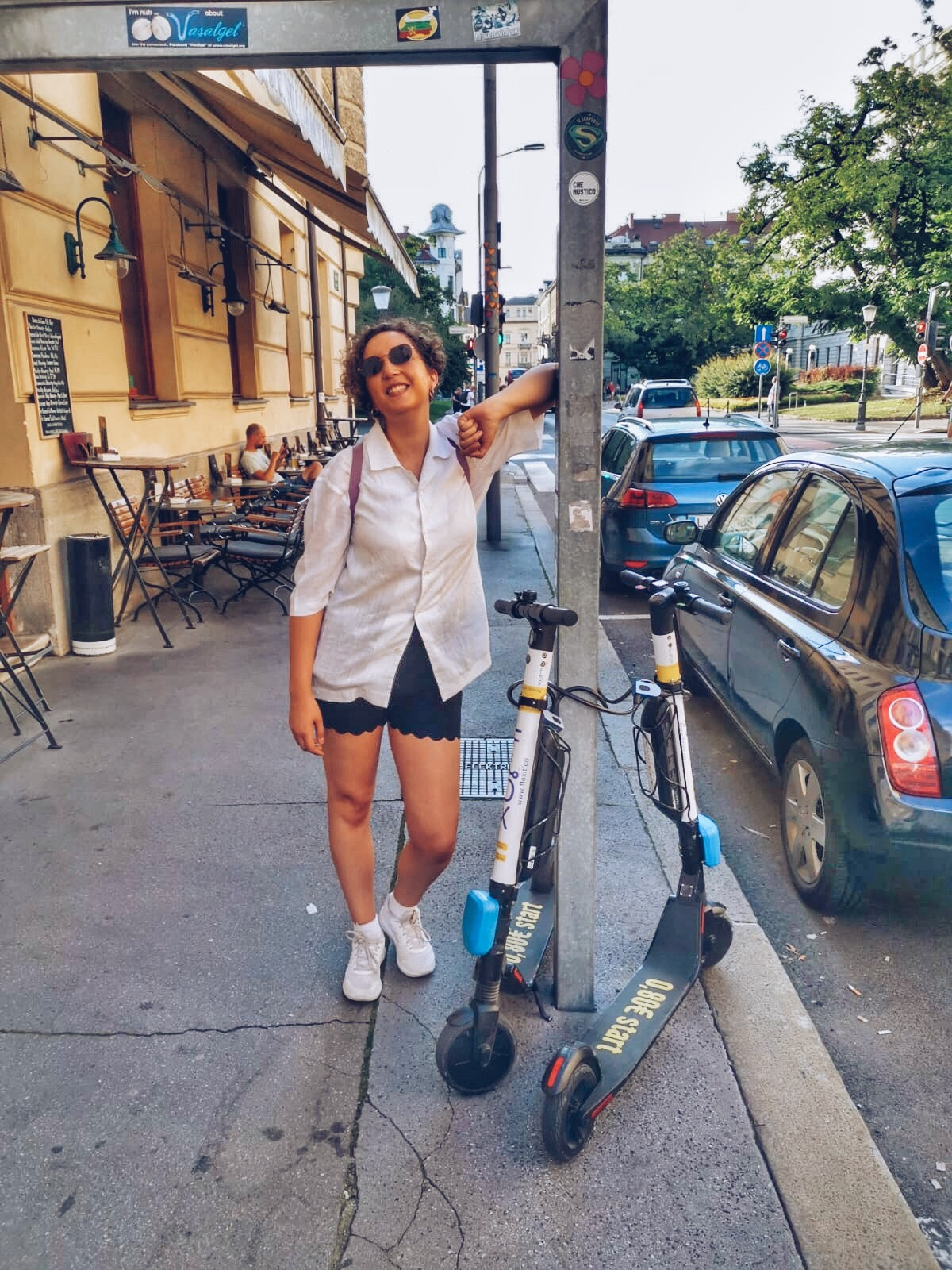 woman next to electric scooters