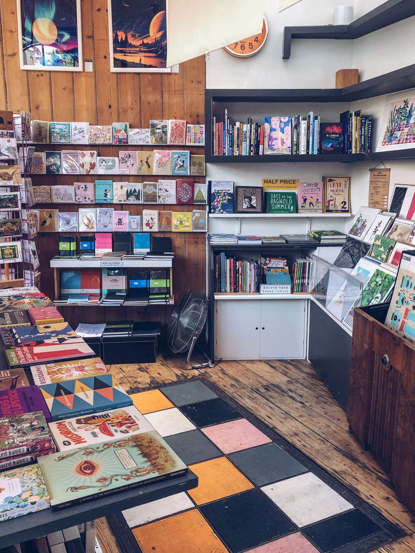 inside here bookshop in bristol with colourful book displays