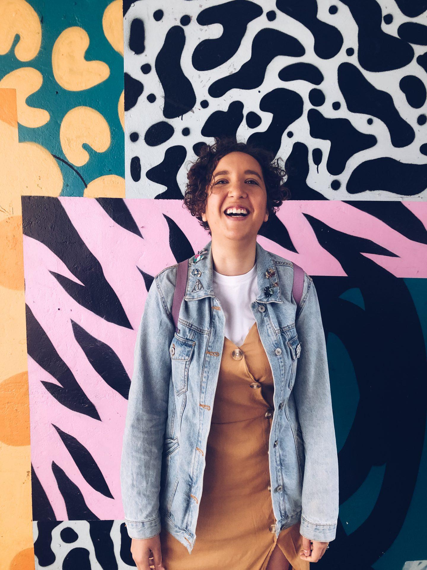 woman in front of street art in bristol