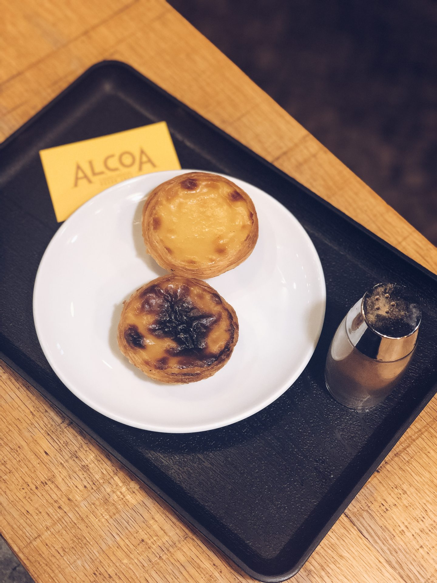 two pastéis de nata on a plate