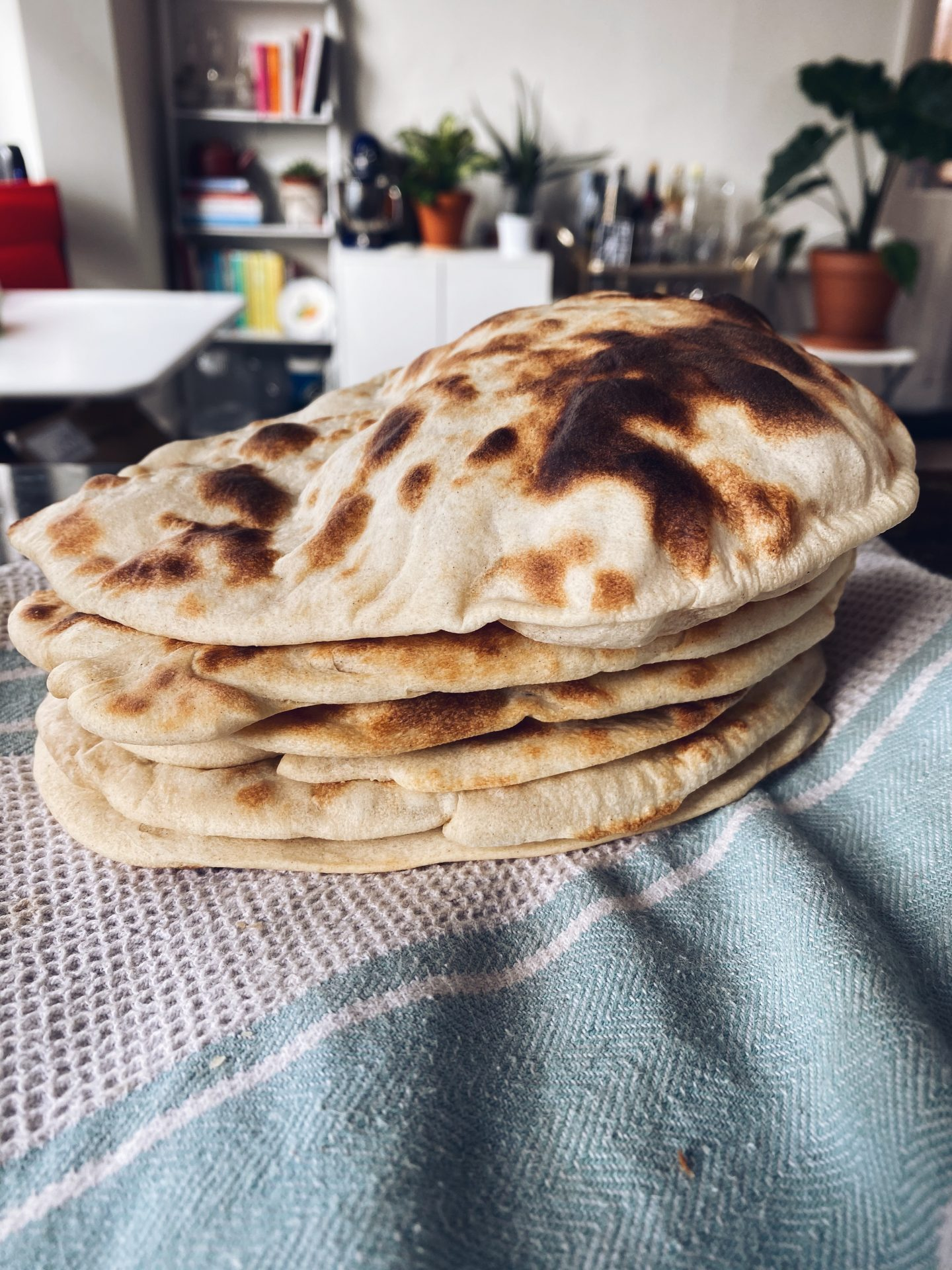 stack of fresh homemade naan bread