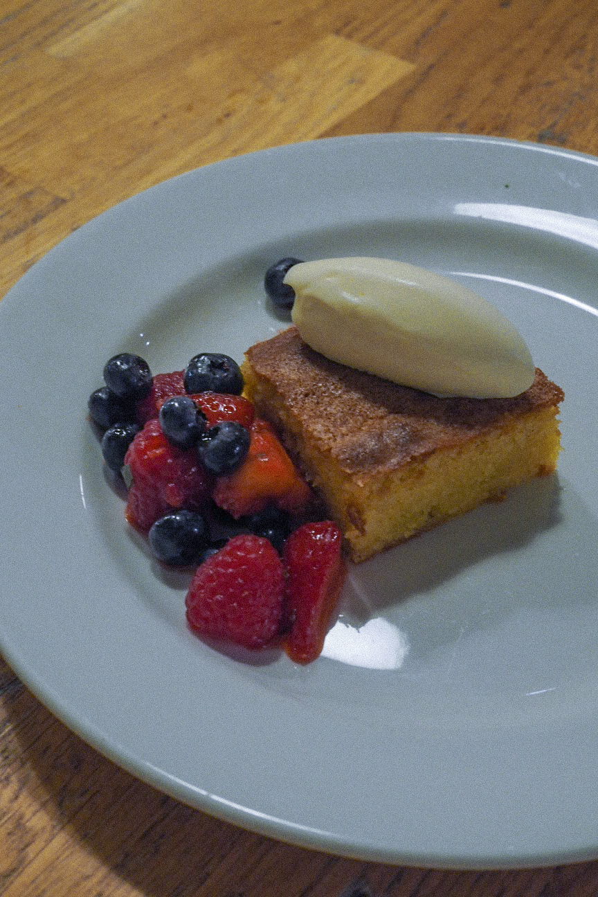 almond cake with berries and cream